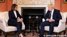 Belarus opposition leader Svetlana Tikhanovskaya (L) speaks with Britain's Prime Minister Boris Johnson during a meeting in 10 Downing street in central London on August 3, 2021. (Photo by Dan Kitwood / POOL / AFP)