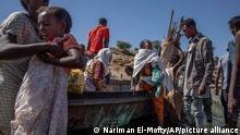 Tigray refugees who fled the conflict in the Ethiopia's Tigray arrive on the banks of the Tekeze River on the Sudan-Ethiopia border, in Hamdayet, eastern Sudan, Tuesday, Dec. 1, 2020. (AP Photo/Nariman El-Mofty)