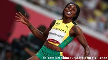 THOMPSON-HERAH Elaine of Jamaica reacts after winning Athletics women's 200m in Tokyo Olympic Games at Olympic Stadium in Tokyo on August 3, 2021. THOMPSON-HERAH Elaine won the event to claim gold medal. ( The Yomiuri Shimbun via AP Images )