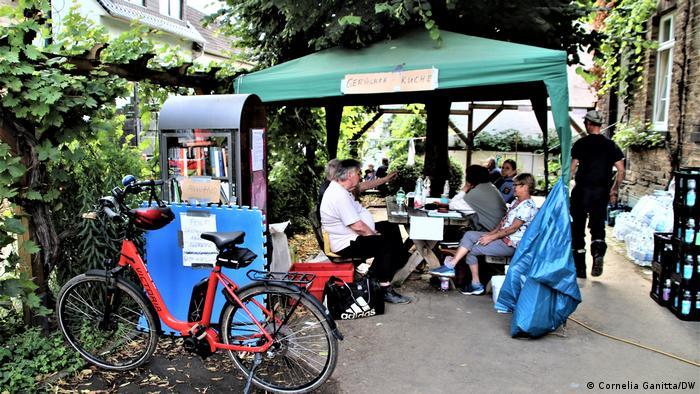 Germany, people sitting in a tent in the Eifel
