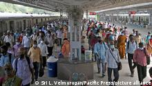 Passengers throng at the local train station after public is allowed to travel in suburban trains following a relaxation of lockdown restrictions imposed to curb the spread of the Covid-19 coronavirus in Chennai. (Photo by Sri Loganathan Velmurugan/Pacific Press)