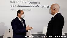 Egyptian President Abdel Fattah el-Sisi, left, speaks with Tunisia's President Kais Saied before the opening session at the Summit on the Financing of African Economies Tuesday, May 18, 2021 in Paris. More than twenty heads of state and government from Africa are holding talks in Paris with heads of international organizations on how to revive the economy of the continent, deeply impacted by the consequences of the COVID-19 pandemic. (Photo by Ludovic Marin, Pool via AP)