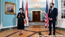 U.S. Secretary of State Antony Blinken listens as Indonesian Foreign Minister Retno Marsudi talks to members of the media after a bilateral meeting at Department of State in Washington, U.S., August 3, 2021. Jose Luis Magana/Pool via REUTERS