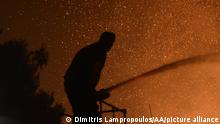 ATHENS, GREECE - AUGUST 03: Flames are seen at forestland after a forest fire at the area of Varybobi, northeastern suburb of Athens, Greece on August 03, 2021. A wildfire broke out Tuesday afternoon in a forest in the Varybobi area in the northeast of Greece's Attica region, spreading fast due to dry conditions in the area, the fire department said. Dimitris Lampropoulos / Anadolu Agency