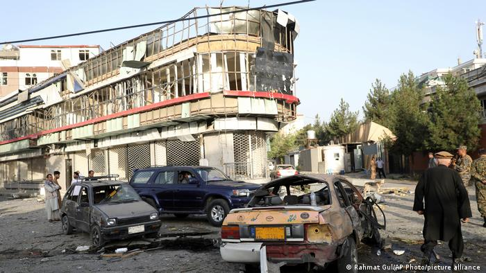 Damaged cars and a damaged building are seen following the attack in Kabul