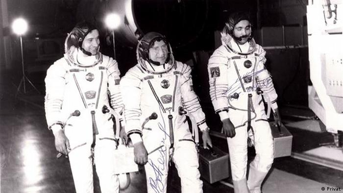Three cosmonauts before a mission