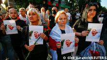 Activists attend a rally next to the Belarusian Embassy to Ukraine to commemorate Vitaly Shishov, a Belarusian activist living in exile who was found hanged in a park near his home this morning, in Kyiv, Ukraine August 3, 2021. REUTERS/Gleb Garanich