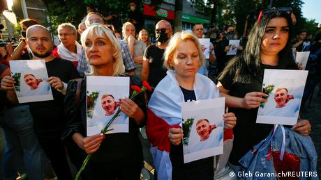 Demonstrators hold photos of Vitaly Shishov, found hanged in a Kiev park this week