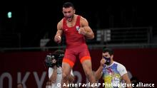 Ukraine's Parviz Nasibov celebrates defeating Egypt's Mohamed Ibrahim Elsayed during the men's 67kg Greco-Roman wrestling semifinal match at the 2020 Summer Olympics, Tuesday, Aug. 3, 2021, in Chiba, Japan. (AP Photo/Aaron Favila)