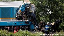 An emergency personnel works on a site of a train crash near the town of Domazlice, Czech Republic, August 4, 2021. REUTERS/David W Cerny