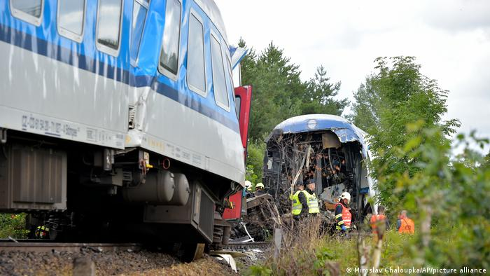 Czech emergency services pictured at the scene of Wednesday's crash involving a German high-speed train and a Czech regional service train