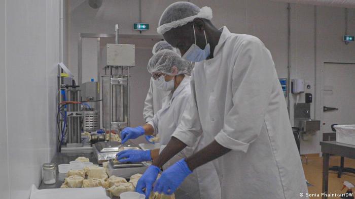 People making cheese at the Les Nouveaux Affineurs production unit.