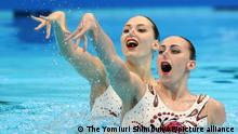Ukraine's FIEDINA Marta and SAVCHUK Anastasiya perform during the Artistic Swimming Duet Free Routine Final in Tokyo 2020 Olympic Games at Tokyo Aquatics Centre in Tokyo on Aug. 4, 2021.The pair placed 3rd in the event.( The Yomiuri Shimbun via AP Images )