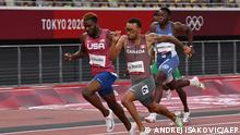 TOPSHOT - First-placed Canada's Andre De Grasse crosses the finish line to win followed by Second-placed USA's Kenneth Bednarek (rear C) in the men's 200m final during the Tokyo 2020 Olympic Games at the Olympic Stadium in Tokyo on August 4, 2021. (Photo by Andrej ISAKOVIC / AFP)