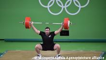 RIO DE JANEIRO, BRAZIL - AUGUST 16: Man Asaad of Syria competes during the Men's weightlifting +105kg Group B on Day 11 of the Rio 2016 Olympic Games at Riocentro - Pavilion 2 on August 16, 2016 in Rio de Janeiro, Brazil. Stringer / Anadolu Agency