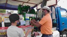 Marktstand an dem Zuckerrohrsaft verkauft wird