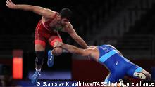 CHIBA, JAPAN - AUGUST 4, 2021: Hassan Yazdani Charati (L) of Iran and Artur Naifonov of the ROC Team fight in their men's -86kg freestyle wrestling semi-final bout during the Tokyo 2020 Summer Olympic Games, at the Makuhari Messe convention centre. Stanislav Krasilnikov/TASS