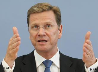 German Foreign Minister Guido Westerwelle gestures during a speech