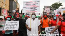 An elderly man match with protesters during #fixthecountry protest in Accra, Ghana, on August 4, 2021. The protest aims to demand accountability, good governance, and better living conditions from government. - Several thousand protesters marched in Ghana's capital Accra on Wednesday in the latest rally against President Nana Akufo-Addo's government under the slogan #FixTheCountry. (Photo by Nipah Dennis / AFP) (Photo by NIPAH DENNIS/AFP via Getty Images)