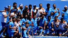 Members of the India team pose for photographs after defeating Germany 5-4 during the men's field hockey bronze medal match at the 2020 Summer Olympics, Thursday, Aug. 5, 2021, in Tokyo, Japan. (AP Photo/John Locher)