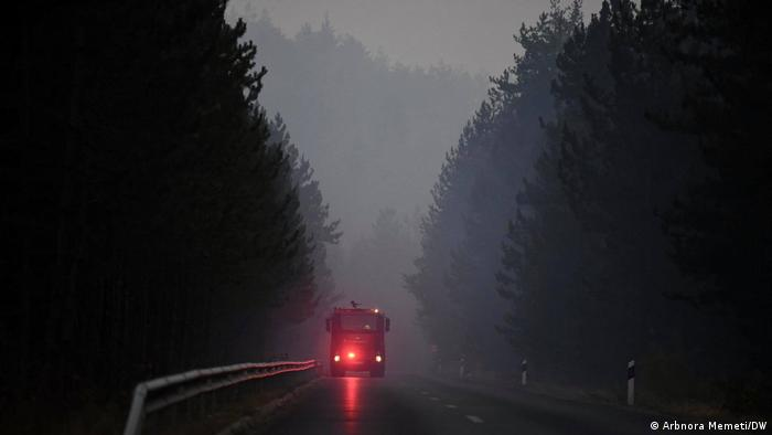A fire truck in action against the forest fires in the region of the town of Pehchevo, North Macedonia