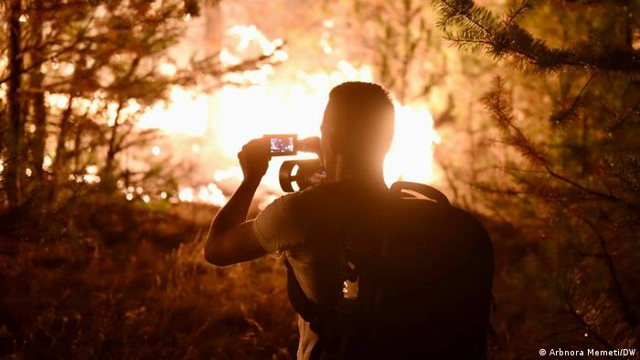 A man photographs a forest fire in North Macedonia