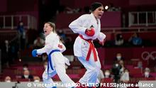 5.8.2021, Tokio, Japan, Sara Bahmanyar of Iran, right, and Serap Ozcelik Arapoglu of Turkey compete in the women's kumite -55kg elimination round for Karate at the 2020 Summer Olympics, Thursday, Aug. 5, 2021, in Tokyo, Japan. (AP Photo/Vincent Thian)