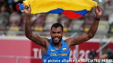 Anthony Zambrano, of Colombia, reacts after his second place finish in the final of the men's 400-meters at the 2020 Summer Olympics, Thursday, Aug. 5, 2021, in Tokyo. (AP Photo/Matthias Schrader)