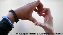MINSK, BELARUS - AUGUST 7, 2020: People form a heart shape with their hands during a motor race in support of soundmen Kirill Galanov and Vladislav Sokolovsky who played Viktor Tsoi's song Khochu Peremen [I Want Changes] during the Open Day of educational institutions backing presidential candidate Svetlana Tikhanovskaya. Minsk's Central District Court has arrested them for 10 days for petty hooliganism and disobedience to police. Nataliya Fedosenko/TASS