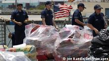 FORT LAUDERDALE, FL - APRIL 24: Crew members of the Coast Guard ship Legare walk among wrapped packages of approximately 12 tons of cocaine and 1 ton of marijuana before offloading them at Port Everglades on April 24, 2018 in Fort Lauderdale, Florida. The drugs worth an estimated $390 million total were seized in 17 separate suspected drug smuggling vessel interdictions in the Eastern Pacific Ocean by multiple U.S. Coast Guard cutters and Canadian Naval vessels. (Photo by Joe Raedle/Getty Images)