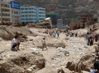 The town of Zhouqu is piled up with debris and mud
