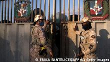 Dominican military agents open the gate on the bridge over the Massacre River to allow Haitians to enter Dajabon, Dominican Republic, from Ouanaminthe, Haiti, on the northern border between the countries, on March 5, 2021. - The border crossing between the Dominican Republic and Haiti is opened on Mondays and Fridays, when Haitians enter the Dominican Republic to buy and sell products in the Binational Border Market, one of the main engines of the economy of the area. Dominican President Luis Abinader announced the construction of a wall along the border between the Dominican Republic and Haiti to reduce illegal migration. (Photo by Erika SANTELICES / AFP) (Photo by ERIKA SANTELICES/afp/AFP via Getty Images)