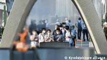 People pray at the Peace Memorial Park in Hiroshima, western Japan, on Aug. 6, 2021, the 76th anniversary of the U.S. atomic bombing of the city. (Kyodo)