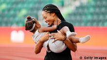 EUGENE, OREGON - JUNE 26: Allyson Felix celebrates with her daughter Camryn after day nine of the 2020 U.S. Olympic Track & Field Team Trials at Hayward Field on June 26, 2021 in Eugene, Oregon. (Photo by Steph Chambers/Getty Images)