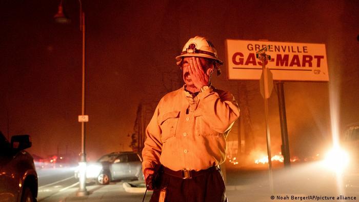 A firefighter rubs his eye in Plumas County, California