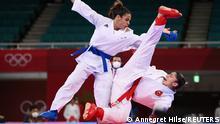 Tokyo 2020 Olympics - Karate - Women's -61kg Kumite - Pool A - Nippon Budokan, Tokyo, Japan - August 6, 2021. Merve Coban of Turkey in action against Leila Heurtault of France. REUTERS/Annegret Hilse