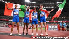 TOKYO, JAPAN - AUGUST 06: Athletics - Olympics: Day 14. Lorenzo Patta, Lamont Marcell Jacobs, Eseosa Fostine Desalu and Filippo Tortu of Team Italy celebrate winning the gold medal in the Men's 4 x 100m Relay Final on day fourteen of the Tokyo 2020 Olympic Games at Olympic Stadium on August 06, 2021 in Tokyo, Japan. (Photo by Matthias Hangst/Getty Images)