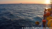 In this September 2018 photo provided by researcher Isabela Le Bras, mooring for measuring equipment is recovered just offshore of Greenland in the early morning with icebergs visible in the background. Scientists were studying the Atlantic Meridional Overturning Circulation (AMOC), a circulation of warm and cold waters that stretches from around Greenland south to beyond the tip of Africa and into the Indian Ocean. (Isabela Le Bras via AP)