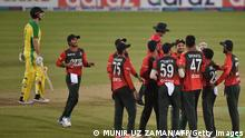 Bangladesh's players (R) celebrate after the dismissal of Australia's Moises Henriques during third Twenty20 international cricket match between Bangladesh and Australia at the Sher-e-Bangla National Cricket Stadium in Dhaka on August 6, 2021. (Photo by Munir Uz zaman / AFP) (Photo by MUNIR UZ ZAMAN/AFP via Getty Images)