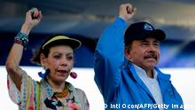 Nicaraguan President Daniel Ortega and his wife, Vice-President Rosario Murillo, raise their fists during the commemoration of the 51st anniversary of the Pancasan guerrilla campaign in Managua, on August 29, 2018. - Ortega called the UN High Commissioner for Human Rights infamous and terror instrument, after it denounced Wednesday systematic human rights violations in the framework of opposition protests in which 300 people were killed. (Photo by INTI OCON / AFP) (Photo credit should read INTI OCON/AFP via Getty Images)