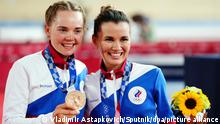 6620033 06.08.2021 Bronze medalists Russian Olympic Committee's Mariia Novolodskaia and Gulnaz Khatuntseva pose during the awarding ceremony after the women's cycling track madison final at the Tokyo 2020 Olympic Games at Azu Velodrome in Azu, Japan. Vladimir Astapkovich / Sputnik