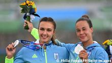 Silver medallists Ukraine's Luidmyla Luzan and Ukraine's Anastasiia Chetverikova celebrate on podium during medals ceremony following the women's canoe double 500m final during the Tokyo 2020 Olympic Games at Sea Forest Waterway in Tokyo on August 7, 2021. (Photo by Philip FONG / AFP) (Photo by PHILIP FONG/AFP via Getty Images)