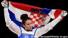 Croatia's Matea Jelic celebrates after winning the taekwondo women's -67kg gold medal bout during the Tokyo 2020 Olympic Games at the Makuhari Messe Hall in Tokyo on July 26, 2021. (Photo by Javier SORIANO / AFP) (Photo by JAVIER SORIANO/AFP via Getty Images)