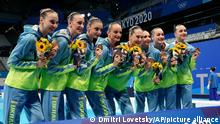 Ukraine's team pose with their bronze medals after artistic swimming, team free routine competition at the 2020 Summer Olympics, Saturday, Aug. 7, 2021, in Tokyo, Japan. (AP Photo/Dmitri Lovetsky)