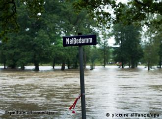 flooded area with sign saying Neissedamm