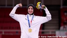 TOKYO, JAPAN - AUGUST 07: Gold medalist Feryal Abdelaziz of Team Egypt poses with the gold medal for the Women's Karate Kumite +61kg on day fifteen of the Tokyo 2020 Olympic Games at Nippon Budokan on August 07, 2021 in Tokyo, Japan. (Photo by Harry How/Getty Images)