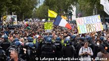 General view of protesters and yellow vest surrounded by gendarmerie forces and police forces during a national day of protest against the compulsory Covid-19 vaccination for certain workers and the mandatory use of the health pass called for by the French government in Paris on August 7, 2021. Protesters took to the streets across France on Saturday for the fourth weekend in a row to rally against a new health pass needed to enter a cafe or travel on an inter-city train, two days before the new rules come into force. A valid health pass is generated by two jabs from a recognised vaccine, a negative coronavirus test or a recent recovery from infection and has been validated for cafes and restaurants by the Constitutional Council on August 5, 2021 Photo by Raphael Lafargue/ABACAPRESS.COM
