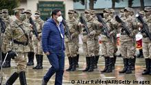 Bolivian President Luis Arce (R) reviews the troops during the delivery of 2 million face masks and a military field hospital donated by China for the fight against the novel coronavirus COVID-19, in El Alto, on February 18, 2021. (Photo by Aizar RALDES / AFP) (Photo by AIZAR RALDES/AFP via Getty Images)