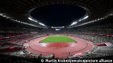 Tokyo 2020 Olympic Games - Day Seven. A general view of the first heat of the Women's 5000 metres in front of empty stands at Olympic Stadium on the seventh day of the Tokyo 2020 Olympic Games in Japan. Picture date: Friday July 30, 2021. See PA story OLYMPICS Athletics. Photo credit should read: Martin Rickett/PA Wire. RESTRICTIONS: Use subject to restrictions. Editorial use only, no commercial use without prior consent from rights holder. URN:61291646