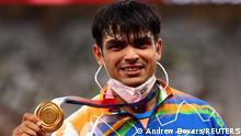 Tokyo 2020 Olympics - Athletics - Men's Javelin Throw - Medal Ceremony - Olympic Stadium, Tokyo, Japan - August 7, 2021. Gold medallist Neeraj Chopra of India reacts on the podium REUTERS/Andrew Boyers